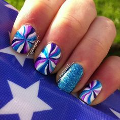 Pinwheel inspired blue nail art design; this design uses white polish as base color with blue glitter polish as well. Blue and violet shades are then used to create the pinwheel effect.