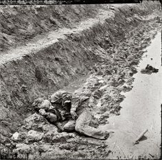 """April 3, 1865. Petersburg, Virginia. """"Dead Confederate soldier in trenches of Fort Mahone."""""""