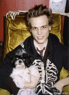 I don't know how I feel about this picture. It's Matthew with a dog in a shirt and tie and a SKELETON hoodie. Hmm