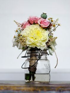 Raechel, have your bridesmaids put their bouquets in the centerpieces to keep down on costs..