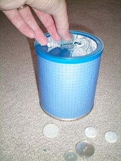 Reuse formula containers. Cut a slit at the top of the container and students can put different objects in. I used buttons but you could also use this as a coin sorting or size sorting activity.