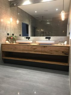 Bathroom - This gorgeous custom floating timber vanity made from solid recycled Messmate timber feautres Omvivo's Venice 700 basins The organic design of the solid surface basins work beautifully with the recyc