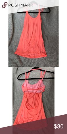 EUC. Lululemon workout tank. This tank has a built in sports bra (no cups for the sports bra). The straps are one around the neck as a halter and the back of the sports bra is two straps horizontally. The tank top has two straps that go over the shoulders then cross cross on the back. This is a loose fit tank but tapers in at the hips.  *All of my lululemon pieces have been washed with other lulu products and hung to dry.*  **Any item that is sold will be freshly washed prior to being mailed…