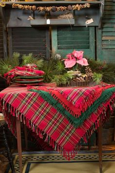 layered fabric in similar colors adds depth to our Cozy December Tablescape / #tartan #red