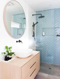 An updated, feminine bathroom idea. Herringbone shower tile in a peaceful aqua contrasts nicely with the round mirror and light wood vanity. So stylish! Bad Inspiration, Bathroom Inspiration, Bathroom Ideas, Bathroom Inspo, Guys Bathroom, Laundry In Bathroom, Master Bathroom, Master Shower, Bathroom Interior Design