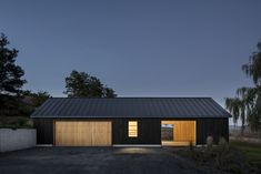 adds minimalist black barn to traditional property in Upstate New York. by Worrell Yeung - US architecture Contemporary Barn, Modern Barn, Modern Farmhouse, Black Architecture, Residential Architecture, Architecture Design, Contemporary Architecture, Farm Shed, Black Barn