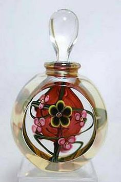"""GlassMaster Roger Gandelman's Midnight Flower Red Perfume Bottle (short version). Light gold luster, pink flowers, highlighted by pretty yellow edged flower in center & red interior bubble. Artist signed/dated, approximately 4.8"""" tall."""