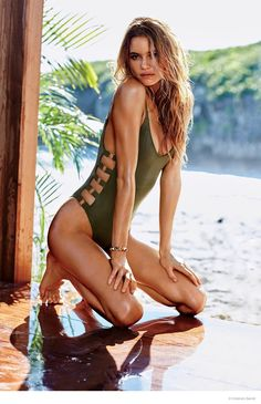 Behati Prinsloo looks hot in a green, cut-out swimsuit look from Victoria's Secret.