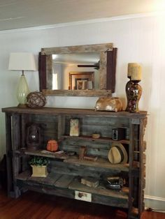 Reclaimed Bookcase from Full Circle Designs!  This piece incorporates reclaimed barn wood, pallet wood, antique oak bed rails, a screen door, and barbed wire.  ~385 SALE!! Was 500!  fullcircledesignsnc.wix.com/fcdnc