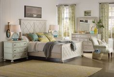 Easy finishes in time-worn, beachy tones of sea & sand distinguish the Sunset Point Fretwork Panel Bed and bachelor's chest.