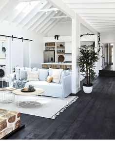 Love the white with dark wood floor.