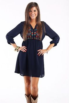 """Easy Native Dress, Navy $47.50 This dress is so great! We love that this piece is modest, yet still comfortable and cute! The elastic waistband is a great feature along with the embroidery at the top! This piece is not lined, so you will need a slip of a long layering tank to wear underneath!   Fits true to size. Miranda is wearing a small.   From shoulder to hem:  Small- 33""""  Medium- 34""""  Large- 35"""""""