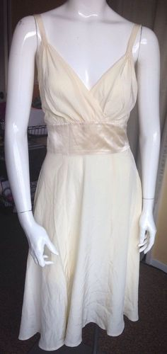 This is a lovely cream cocktail (lightest yellow) sleeveless dress by Trashy Diva. 100% silk. Total length 43 1/2 and if the dress is been worn more like 42 1/2 to compensate for the arm widening the strap. | eBay!
