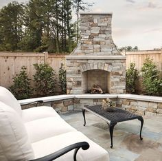 eliminate hearth. I like the shape, trees on either side. Maybe dwarf ornamental olive of italian cypress
