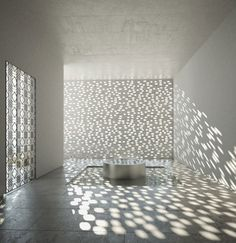 LOVE this perforated wall! The sunlight is so beautifully filtered.