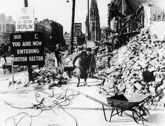 """Berlin's women, the so-called """"rubble women,"""" clean up debris near the Berlin Zoo, 1945."""