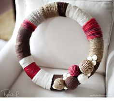 Styrofoam wreath foam wrapped with... fabric, twine, yarn, whatever the heck you want!  Cute!