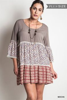 Plus Size super cute boho peasant dress with a material blocked effect. Gorgeous, flowy dress that will be your new favorite. Perfect for any occasion that comes your way. Mocha colored top with cute bottom materials for your color. Fits true to size and feels great. Made of high quality 65% cotton and 35% polyester for the best feel and easy care.