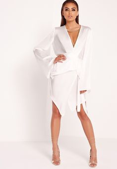 Ensure your wardrobe is on fleek with our all white mini dress! Take it now or lose it forever! In a luxe super soft material with belted detailing, kimono sleeve design and super sexy wrap over style - get it or regret it! Team up with hee...
