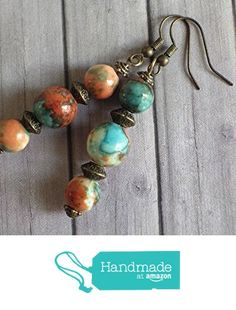 Thurcolas pendant earrings in natural white jade beads stained in brown, orange and blue beads and Tibetan beads Beautiful Hippie Chic pendant earrings crafted in France with white jade beads tinted in blue, brown and orange and Tibetan pearls. The set is very chic, you will love it. The whole is mounted on French hooks in antique bronze. Style: Bohemian, boho, gypsy, tribal, ethnic