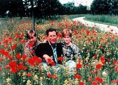 Royal Family Christmas Card (1994) | For the second year in a row, Prince Charles posed with his growing guys outdoors, this time in a field with festive red flowers.
