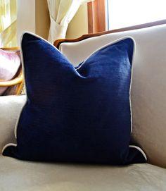Navy-blue chenille velvet fabric is combined with piping made of off- white Alhambra Internationals upholstery velvet to create the modern velvet