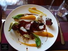 Kudu loin with licorice glaze, butternut puree, confit tomatillo and wilted greens at Ryan's Kitchen for lunch