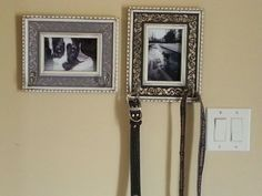 DIY Dog leash holders. Robe hooks attached to framed pics of my puppy. I had to use shorter screws than what came with hooks.