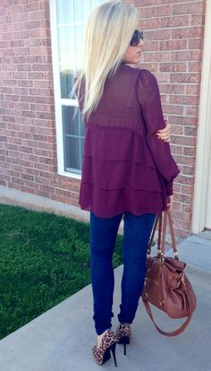 Love the ruffles on the back of this plum blouse.