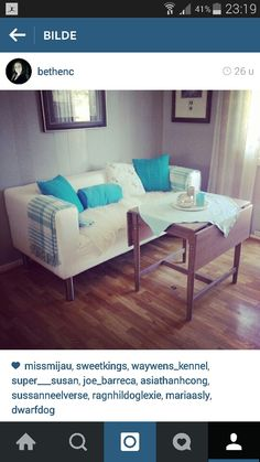 Ikea klippan sofa with longer legs to Make it fit to the dining table.