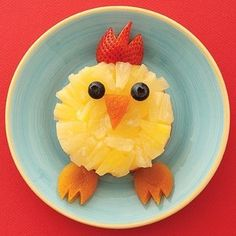 Duck made of pineapple and carrots..