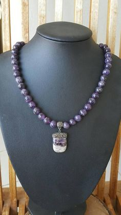 10 mm natural amethyst beads strand with amethyst pendant. ABOUT Jewelry Designer of Emotional Dreams offers an exciting collection, designed and handmade by designer herself. You will find a selection of rich gemstone designs. We hope that you will enjoy wearing our designs as much