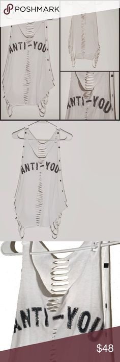 """✂️ Cut up revamped Tumblr graphic muscle tank/tee Cut into a muscle tank/tee, this is an oversized """"anti-you"""" white shirt. It has added glitter/sparkle to the words (hard to tell in photos) and added studs along the back of the arms. Brand new, without tags. Fresh crisp white. Sides both sliced and can hang Or be tied up. Sliced down the entire back. Thin material. Size large.  #antiyou #muscletank #muscletee #sleeveless #cutoff #sliced #shredded #cutup #custom #tumblr #whitetee #stud…"""