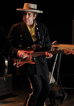 This 2009 shot shows Dylan live on stage. He has played over 2500 gigs and frequently changes the arrangements of his older songs, as well as his singing style, to keep audiences guessing.