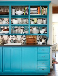 buffet hutch with wallpaper - don't like the color but I like the shelves above with cabinet below and a counter for cutting boards, hole punchers etc.    Rethinking bookshelves!