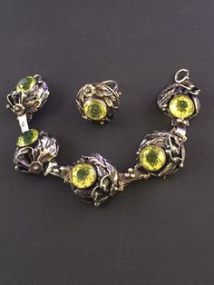 A personal favorite from my Etsy shop https://www.etsy.com/listing/265268813/vintage-chain-link-bracelet-ring-peridot