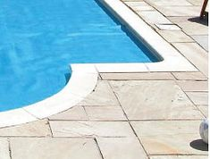 Image result for swimming pools with white coping and bluestone patio