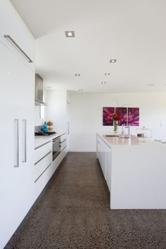 The white kitchen, grey polished concrete floor and splash of pink are beautiful!