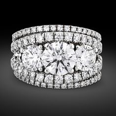 Jewelry Diamond : Three round brilliant diamonds totaling carats dazzle in the engagement rin. - Buy Me Diamond Pearl Jewelry, Diamond Jewelry, Antique Jewelry, Fine Jewelry, Bridal Ring Sets, Bridal Rings, Diamond Wedding Sets, Simple Jewelry, Diamond Bands