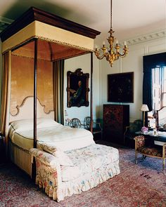 One of the many guest rooms at the 18th-century William Kent–designed Houghton Hall, home to the seventh Marquess of Cholmondeley. Like all good British country homes, this room features period furnishings and a chintz-upholstered chaise lounge.
