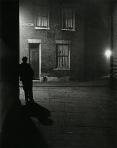 Bill Brandt London, 1937 From The Photography of Bill Brandt. The use of black and white as well the uses of shadow create a very good mysterious tone within the image. Bill Brandt Photography, City Photography, Loneliness Photography, Mysterious Photography, Night Time Photography, Man Ray, Chiaroscuro, London Photos, Nocturne