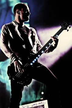 Chris Wolstenholme of Muse playing at Reading festival in 2011.
