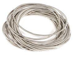 Piano Wire Silver Eternity Bracelets - Set of 18 Stackable Strands - Sleek Silver - Packaged in an Organza Jewelry Gift Bag Spire Arts,http://www.amazon.com/dp/B008RGINJY/ref=cm_sw_r_pi_dp_KslFrb0317004DB7