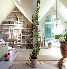 DIY tip: brighten your attic reading nook with white paint, natural light, and large, green plants.