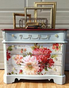 Just finished this. I decoupaged a poster onto the drawers, painted in a custom light gray paint. Painted the top red then added a dark stain over it. Highlighted detailed areas with a dark wax then went over the whole thing with a light antique wax. And...she's up for sale!😊 The poster is from Hobby Lobby. #Shabbychicfurniture