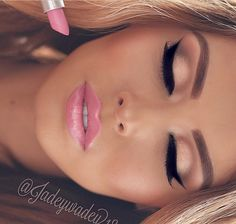 On her barbie look, her eyes are lined with Girlactik.com precise marker liner in black noir.