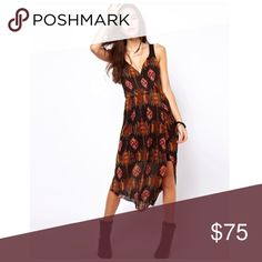 💟Free People Aztec Asymmetric Open Back Dress Size medium. Plunge neckline. Fitted high waist / empire waist. Shirred back panel. High low dress. Easy care poly fabric. EUC $128  💟Fast 1-2 day shipping 💟Reasonable offers accepted 💟Purchase 3 or more items & get a special bundle rate!  💟Smoke-free home Free People Dresses Asymmetrical