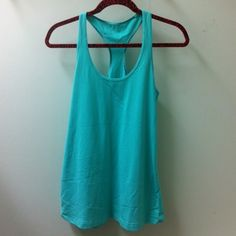 Lululemon - Aqua Tank Top. Excellent condition. Not sure if it is Medium or Large. That is final price. Firm price and no trade. lululemon athletica Tops Tank Tops