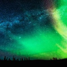 """""""When the Milky Way meets the Aurora Borealis, magic happens :) I took this photo in Fairbanks this past February during one if he most amazing trips if my life :) #northernlights..."""