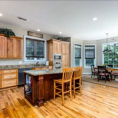 Gourmet kitchen highlight the hickory flooring and cabinetry, stainless steel appliances, 6 burner gas stove, center island, and breakfast room with access to the back deck. Listed in Vienna Virginia by The Casey Samson Team is a Wall Street Journal Top Team in Northern Virginia.